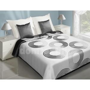 Prehoz na postele bielej farby s čiernymi kruhmi