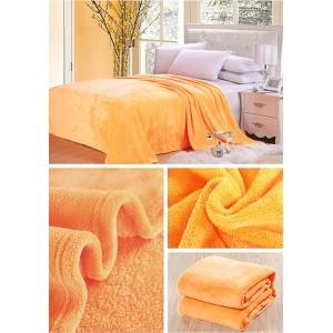 Deky a prehozy pomarančovej farby na sedaciu súpravu