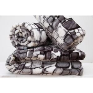 Sivé prehozy na gauč s motívom kameňov