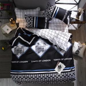 Vzorované obojstranné posteľné obliečky čierno bielej farby s modrými pásmi