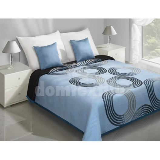 Modrý prehoz na posteľ s čiernymi kruhmi