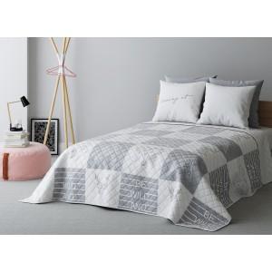 Obojstranný prehoz na posteľ so štvorcami