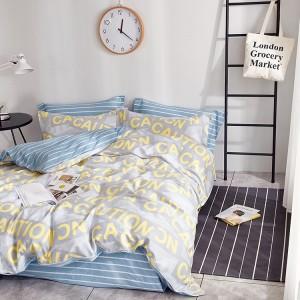 Štýlová posteľná obliečka v sivej farbe s žltými nápismi CAUTION