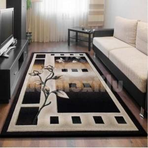 Klasický hnedý koberec s motívom kvetu