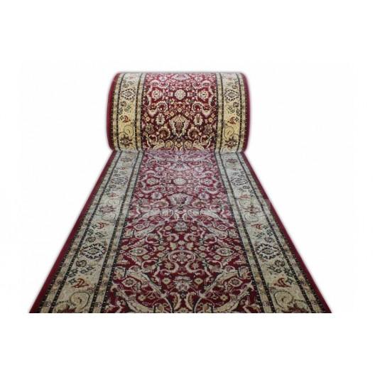 Široký metrážny koberec v červenej farbe
