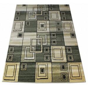 Kvalitný koberec zelenej farby s geometrickým vzorom