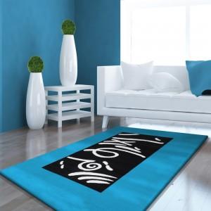 Tyrkysový koberec s potlačou v strede