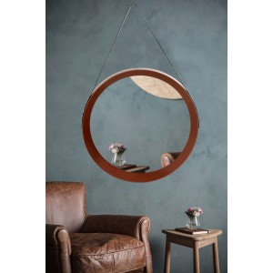 Trendy okrúhle zrkadlo v medenej farbe s čiernym závesným popruhom