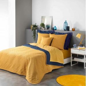 Moderný žlto modrý prehoz do spálne