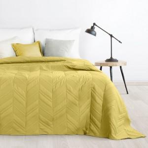 Moderný prehoz do spálne v žltej farbe