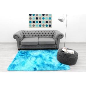 Ombre plyšový koberec modrej farby
