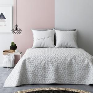 Bielo sivé obojstranné prikrývky na posteľ a abstraktným vzorom