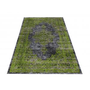Vzorovaný koberec zelenej farby