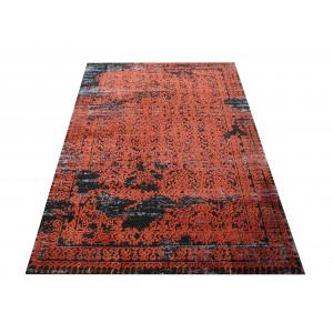 Vzorovaný koberec oranžovej farby