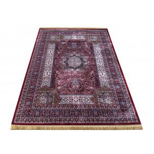 Orientálny koberec v odtieňoch červenej farby