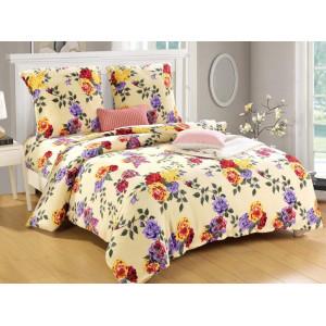 Žiarivé posteľné obliečky žltej farby s kvetinovou potlačou