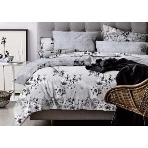 Jadnoduché posteľné oblečenie v šedých odtieňoch s kvetmi