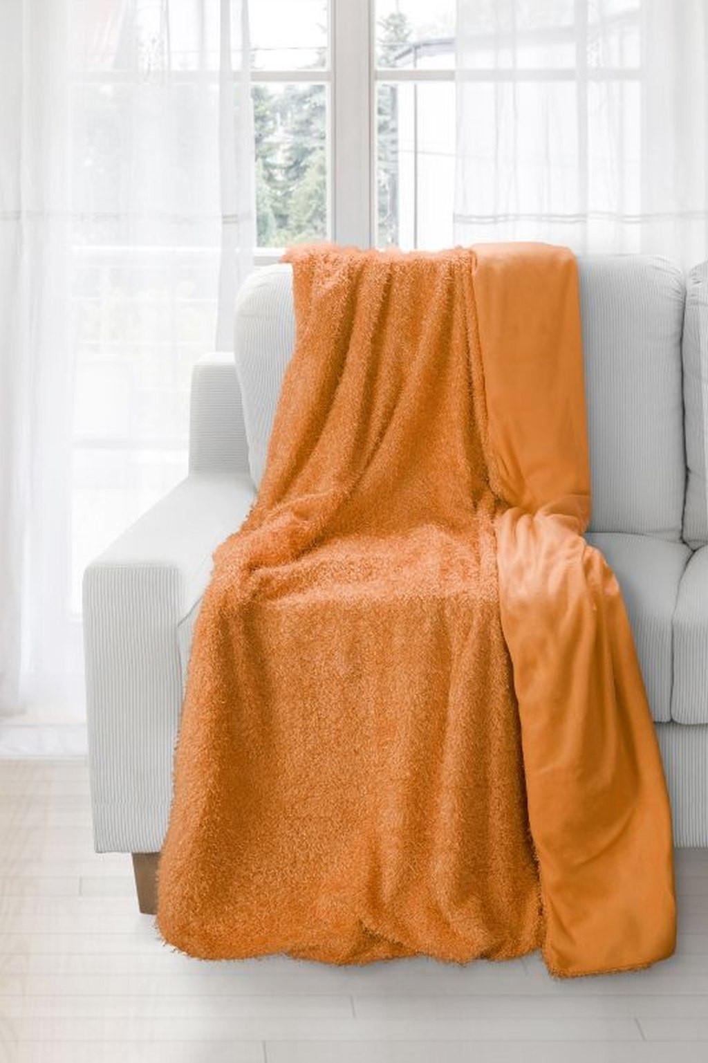 Kvalitná chlpatá deka vo výraznej oranžovej farbe Šírka: 70 cm. dł. 150 cm