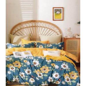 Bavlnené obojstranné modro žlté posteľné obliečky s kvetmi