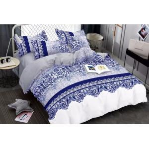 Biele posteľné obliečky s modrými ornamentmi