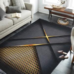 Originálny čierno zlatý koberec do obývačky so strapcami