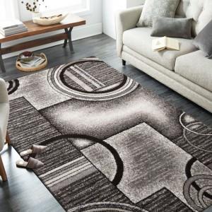 Originálny sivo hnedý koberec s motívom abtraktných kruhov