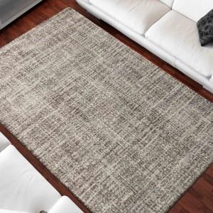 Moderný jednofarebný béžový koberec do obývačky