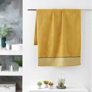 Kvalitný žltý bavlnený ručník s jemným vzorom 70 x 130 cm