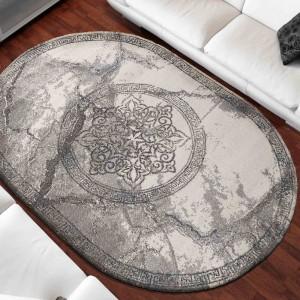 Luxusný sivý oválny koberec s originálnym vzorom