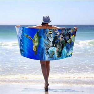 Originálna modrá plážová osuška s motívom podmorského sveta 100 x 180 cm