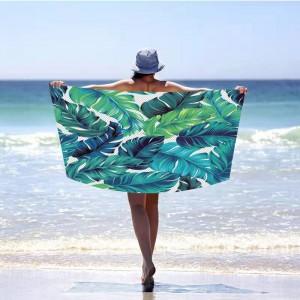 Zelená plážová osuška s exotickými listami 100 x 180 cm