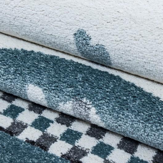Moderný modrý koberec do detskej izby sloník šťastia
