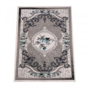 Krásny sivý koberec s kvetinovým vzorom