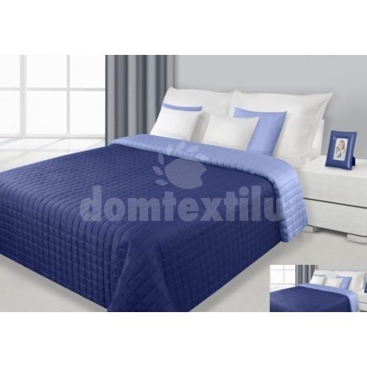 Prehoz na posteľ tmavomodrej farby s prešívaným vzorom