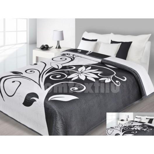 Prehoz na posteľ bielej farby s čiernymi vzormi