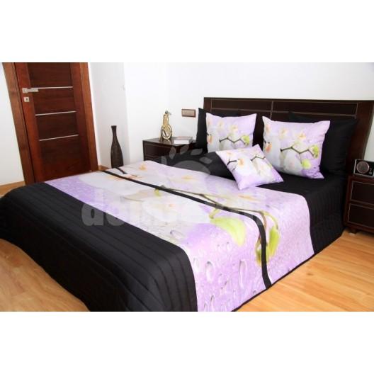 Čierne prehozy na posteľ s bielymi orchideami