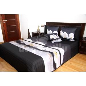 Čierny prehoz na posteľ s bielymi orchideami