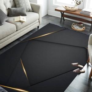 Moderný čierny koberec s abstraktným vzorom