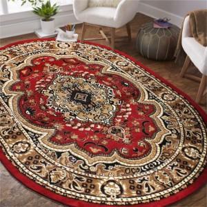 Oválny vintage koberec červenej farby