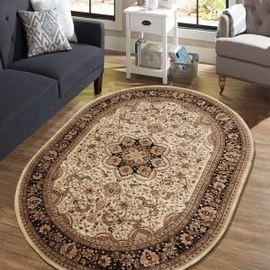 Exkluzívny oválny koberec v krémovej farbe