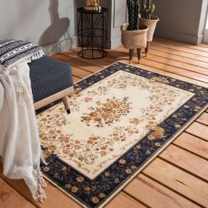 Kvalitný krémovo modrý koberec s motívom kvetov